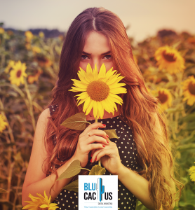 BluCactus - graphic design Trends in 2020 - girl holding a sunflower with a flower background