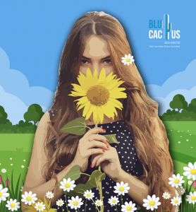 BluCactus - Girl with long hair smelling a sunflower with skyblue background