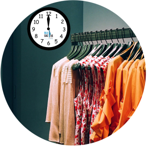 BluCactus - clothes in a rack with the time behind