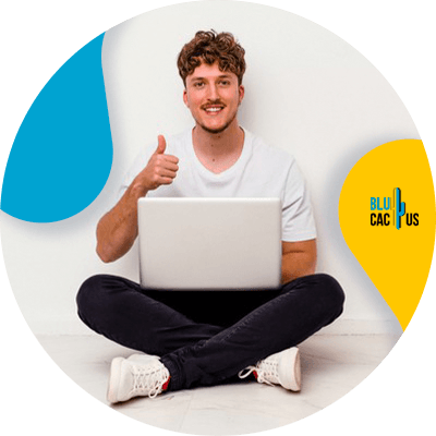 Blucactus - Increase Workflows Efficiency - A man with his thumb up while using a laptop